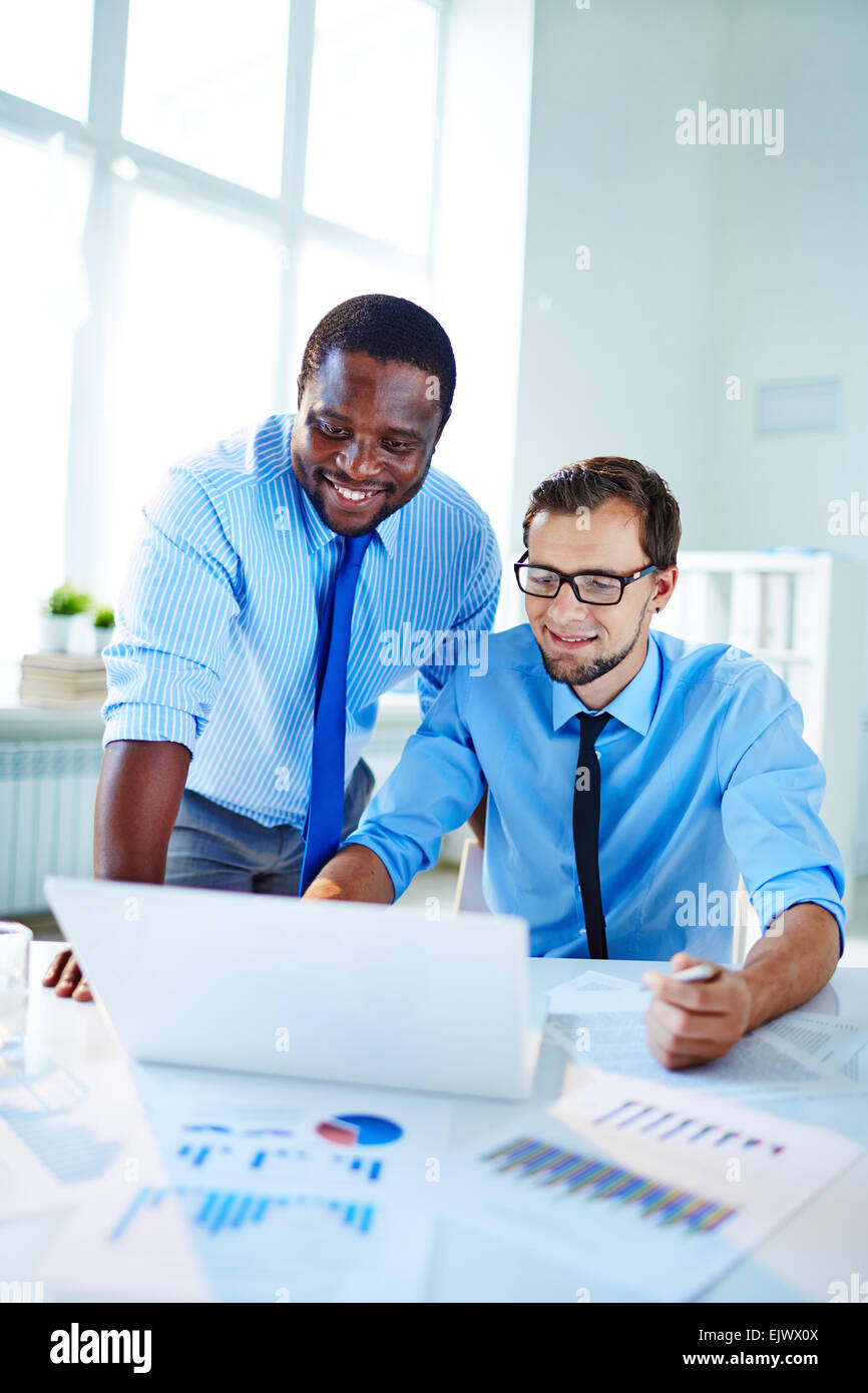 Two confident employees networking at meeting - Stock Image