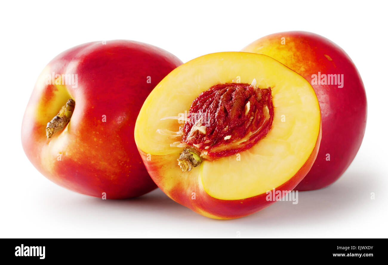 Ripe juicy nectarines isolated on white background - Stock Image