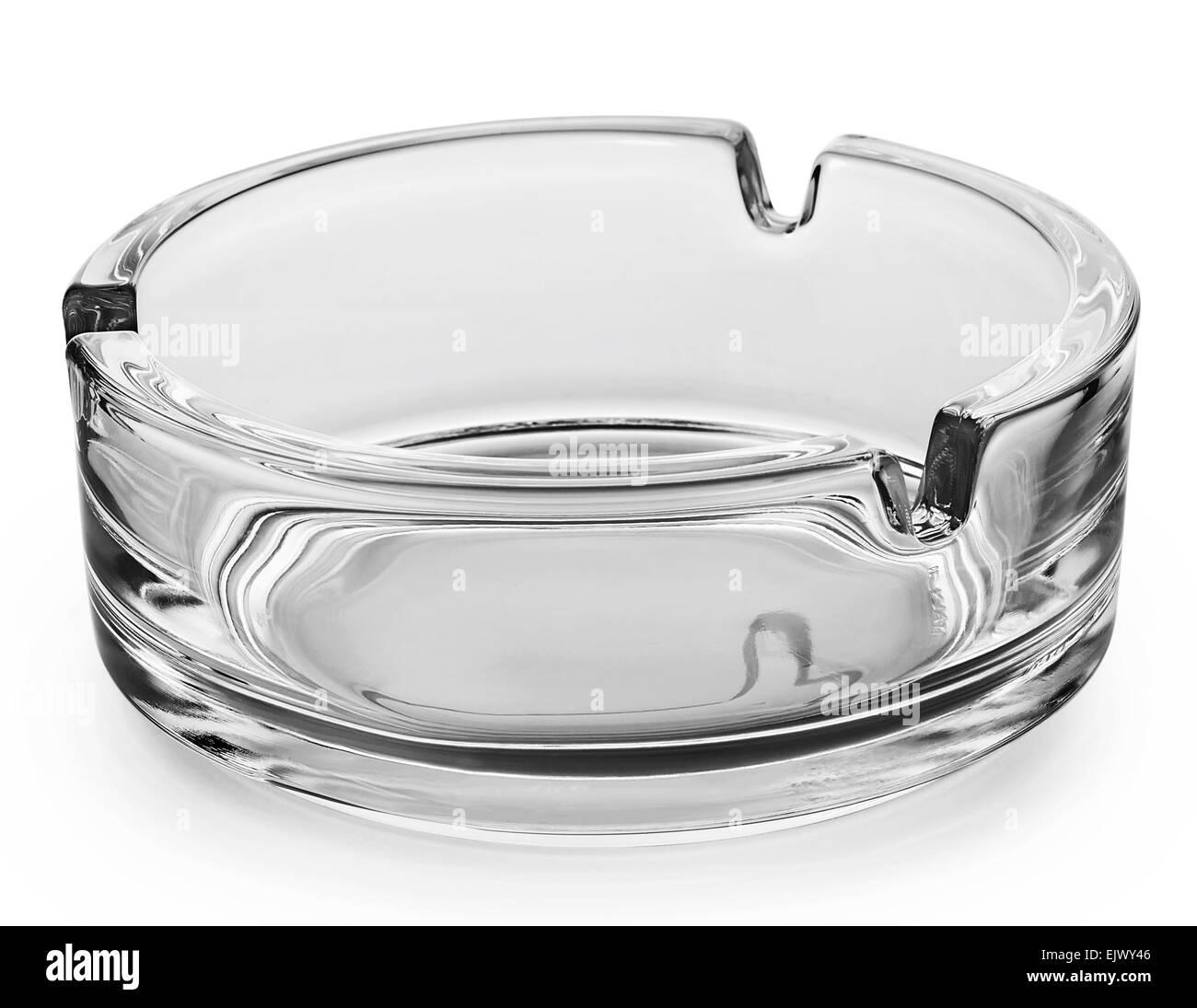 Round glass ashtray isolated on white background - Stock Image
