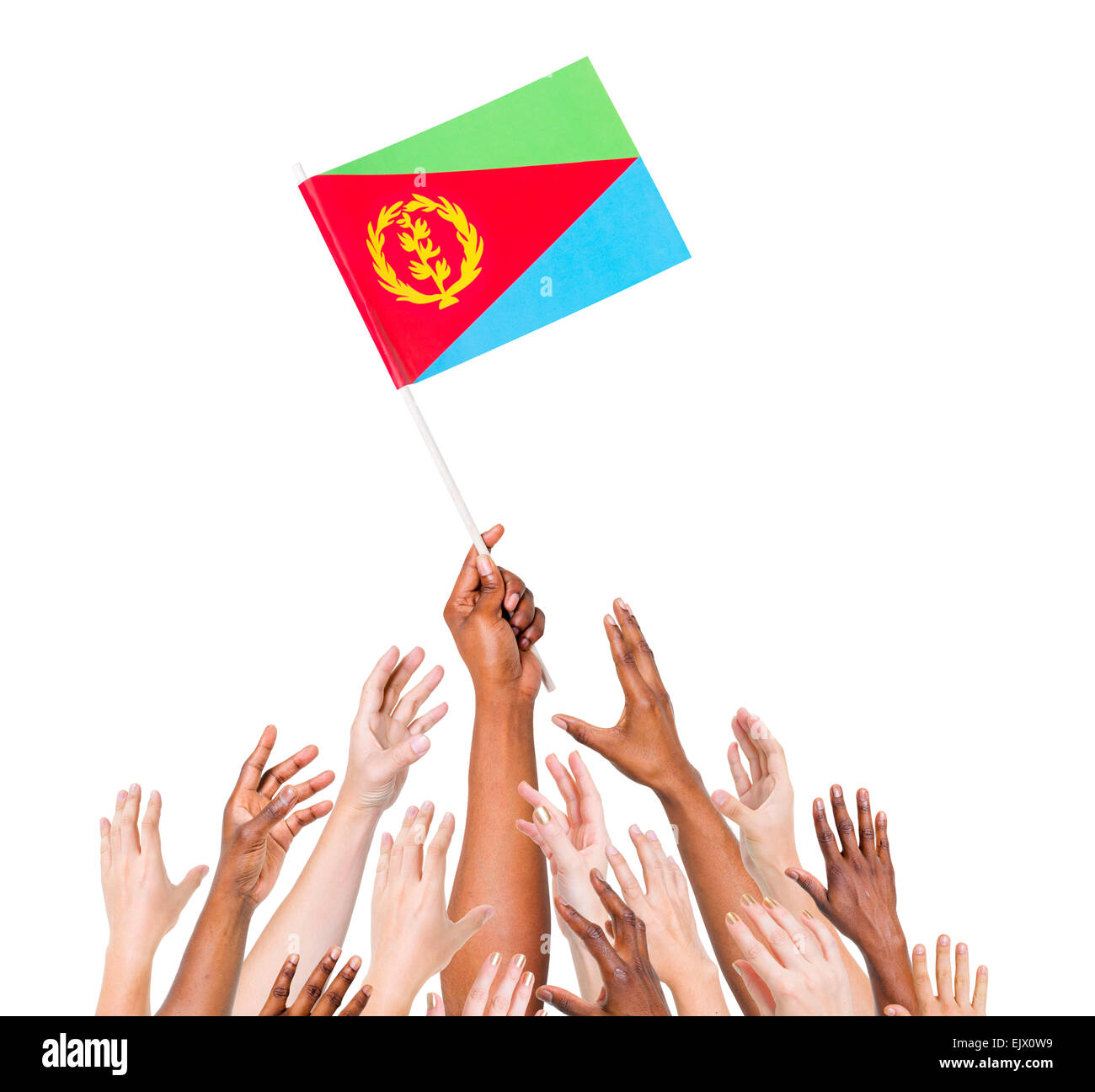 Group Of Multi-Ethnic People Reaching For And Holding The Flag Of Eritrea - Stock Image
