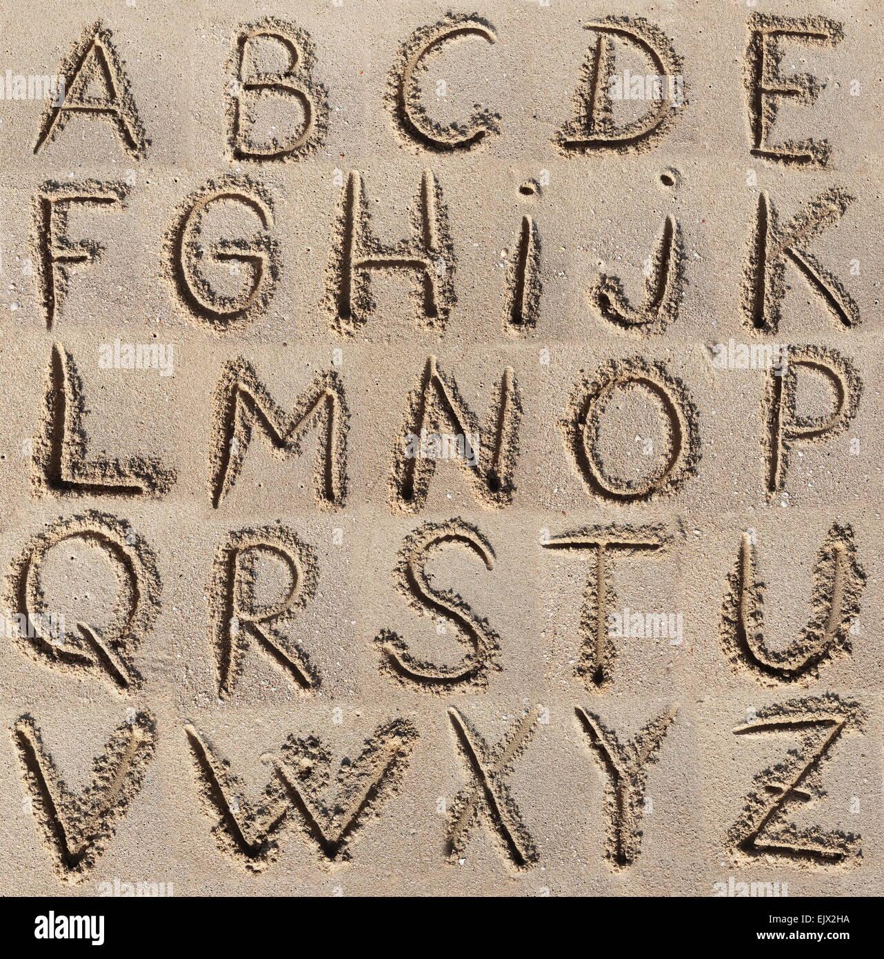 Alphabet (ABC) written on sand. - Stock Image