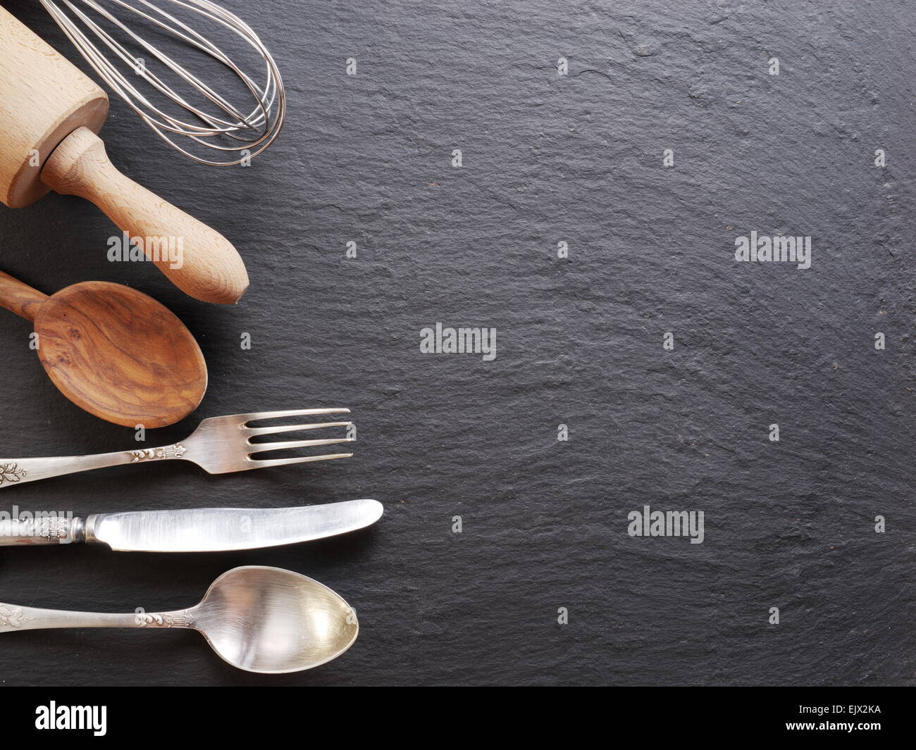 kitchen utensils background culinary cooking utensils on dark gray background background stock photo 80478142 alamy