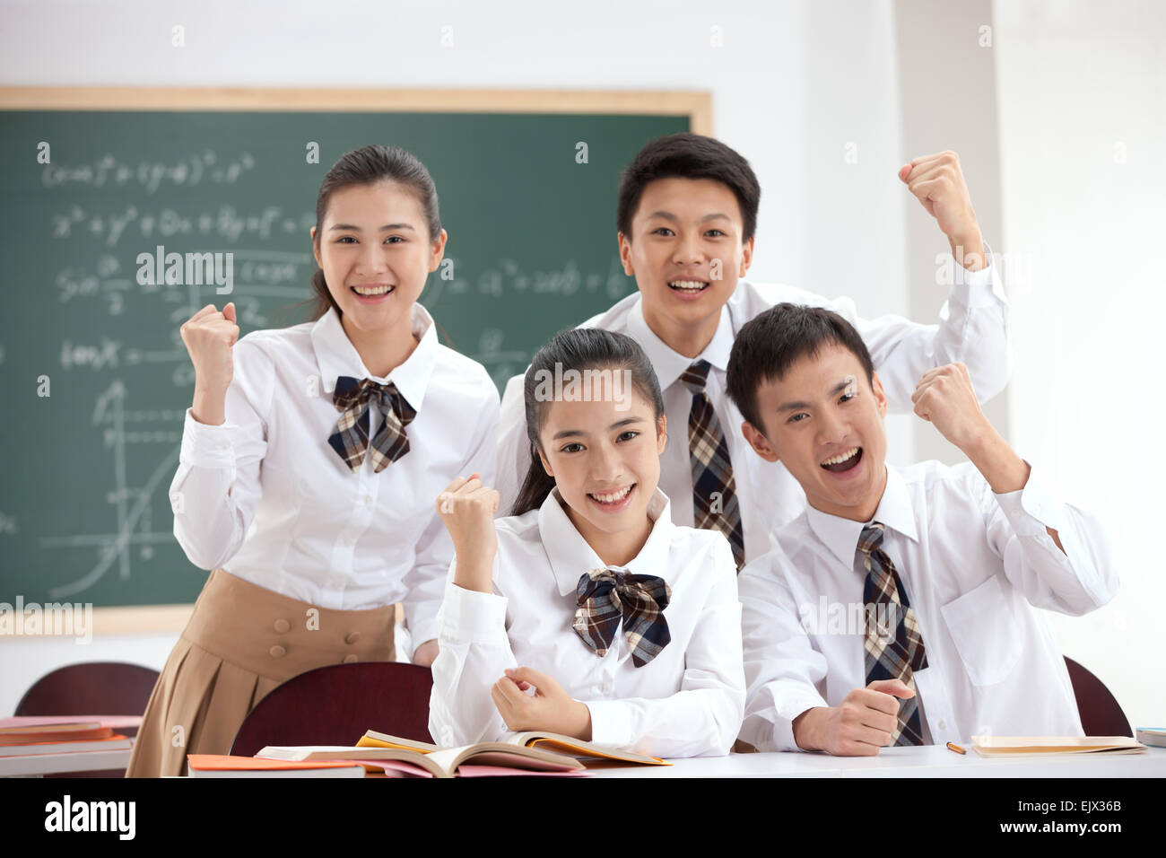 High school students to do fist gesture in the classroom - Stock Image