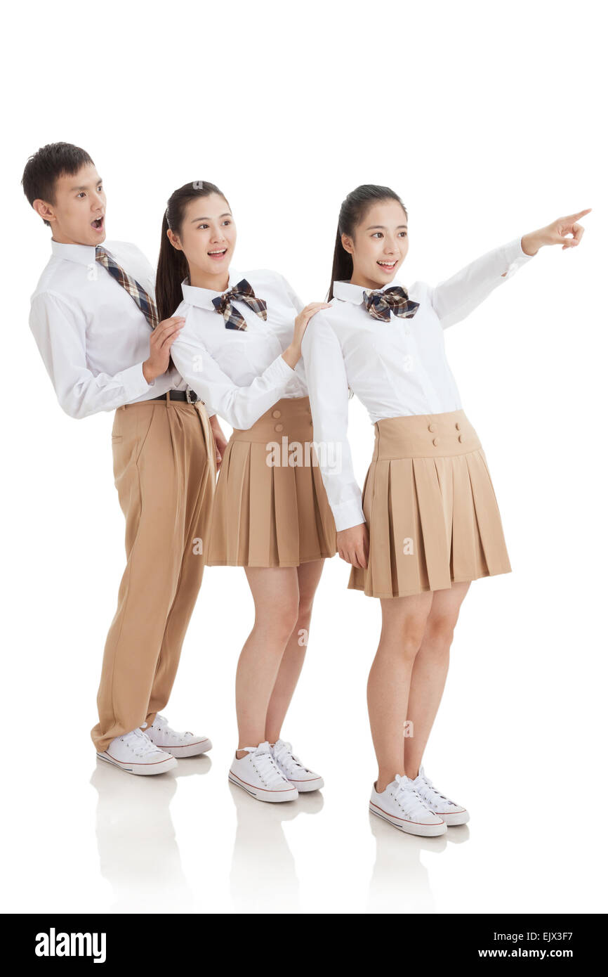 Three high school students are surprised to see to the side Stock Photo