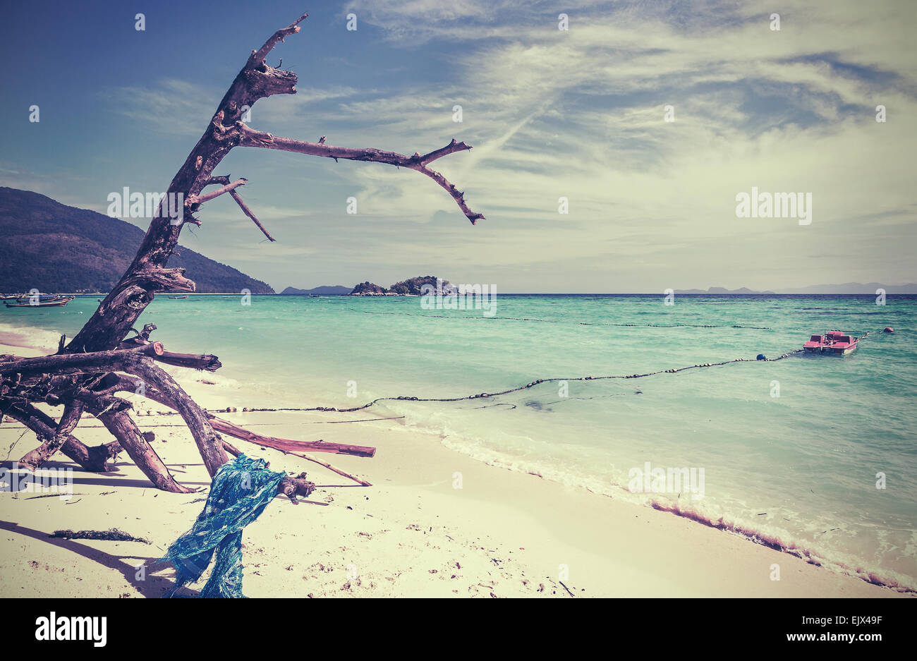 Retro vintage stylized picture of a beach; old grainy film effect. - Stock Image