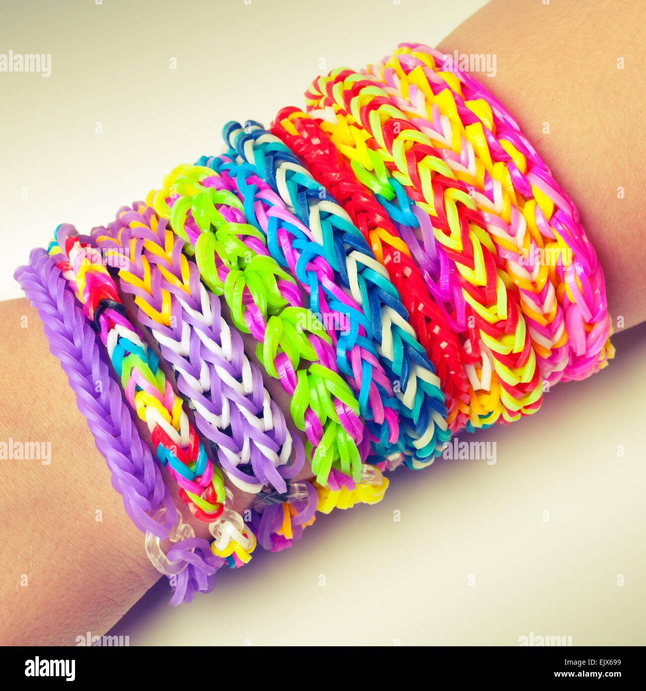 colorful rubber rainbow loom band bracelets on wrist trendy kids stock photo 80480997 alamy. Black Bedroom Furniture Sets. Home Design Ideas