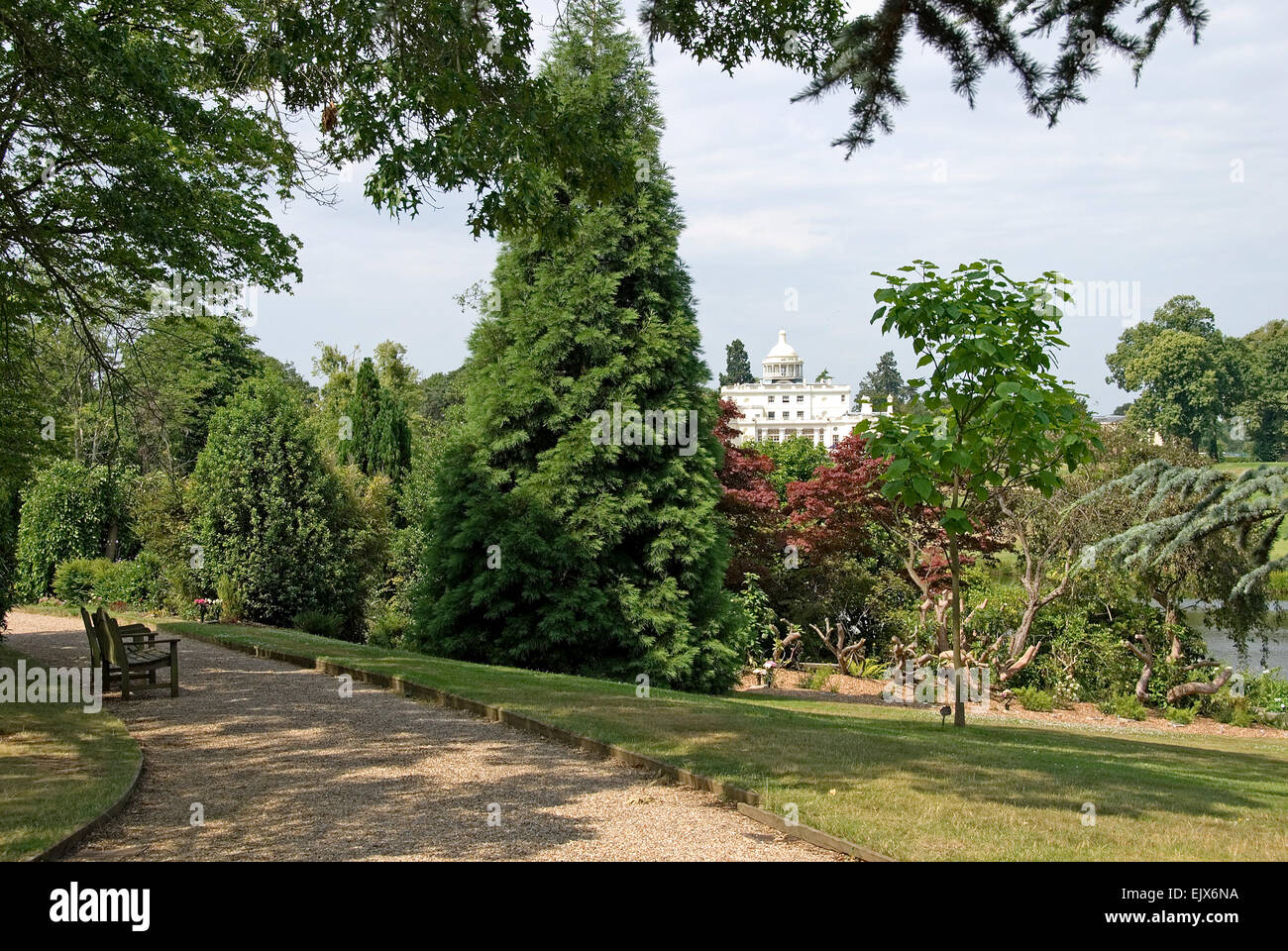 Bucks - Stoke Poges - view to Stoke Park - late Georgian mansion - seen amid trees from path in nearby memorial - Stock Image
