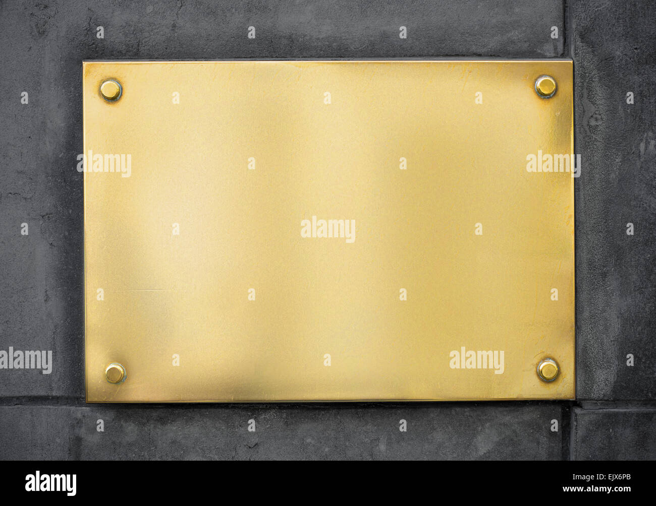 blank gold metal signboard or nameboard on concrete wall Stock Photo ...