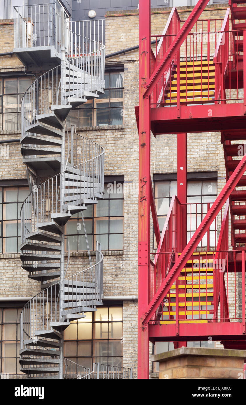 Spiral and conventional stairs, London - Stock Image