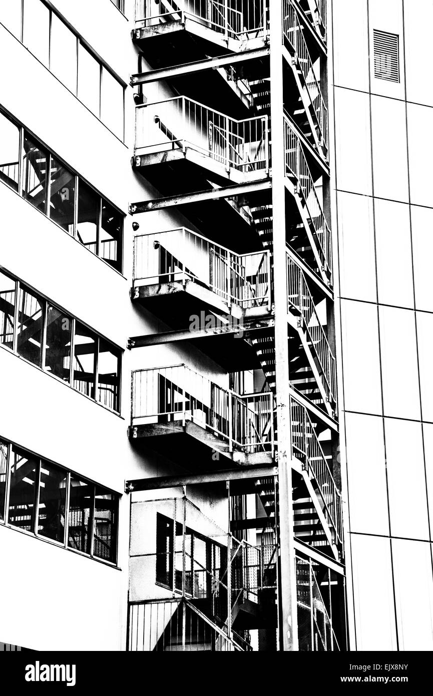 Artistic high contrast Black and white image of emergency staircase - Stock Image