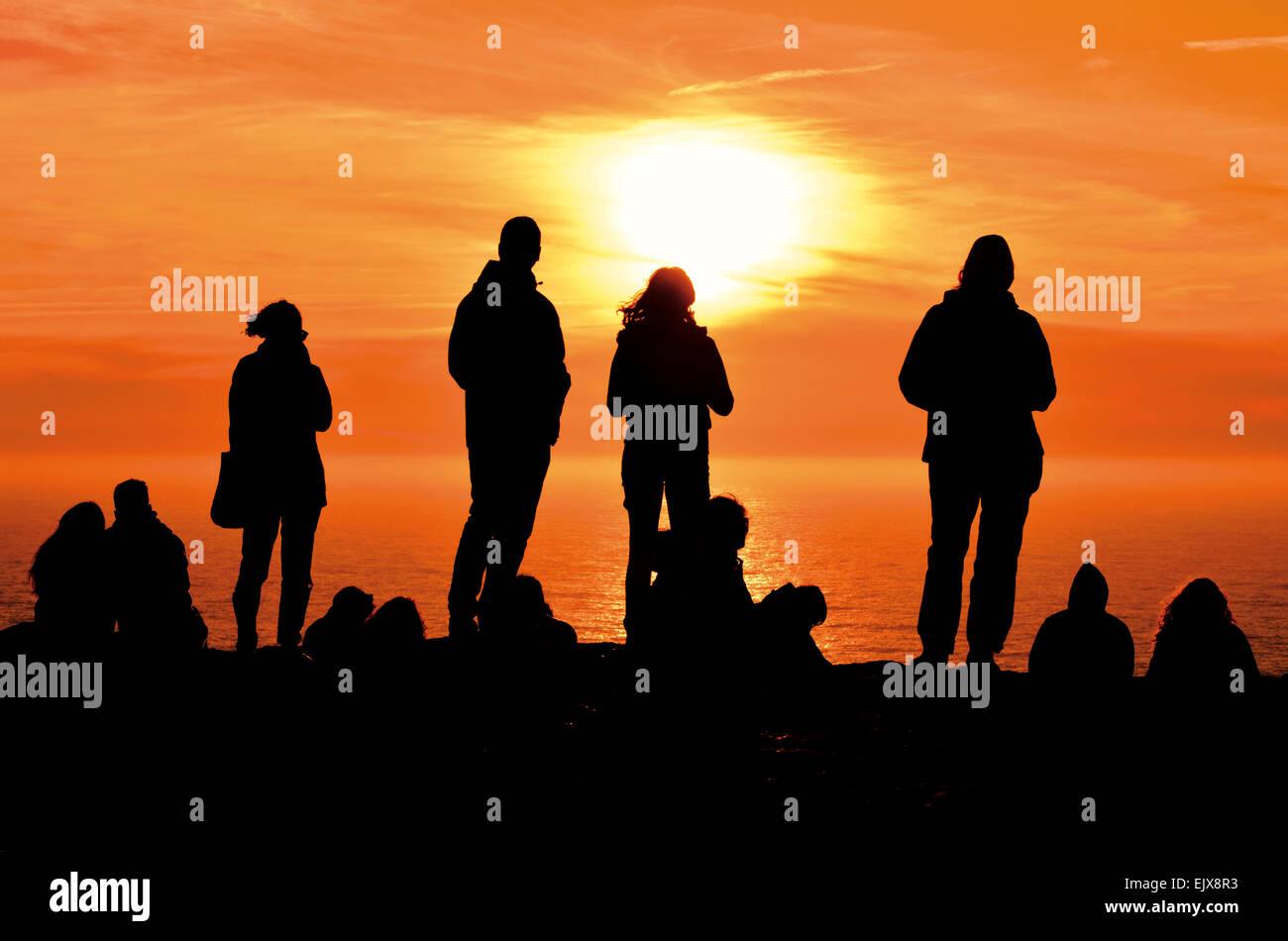 Portugal, Algarve: Tourists enjoying scenic sunset at Cape St. Vincent Stock Photo