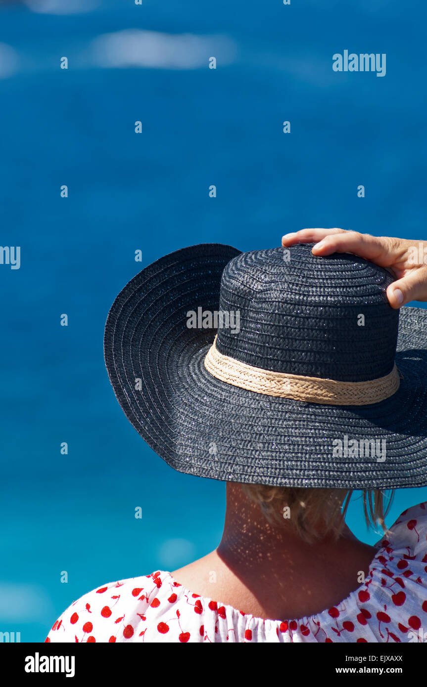 Rear view of a woman overlooking the Mediterranean sea - Stock Image