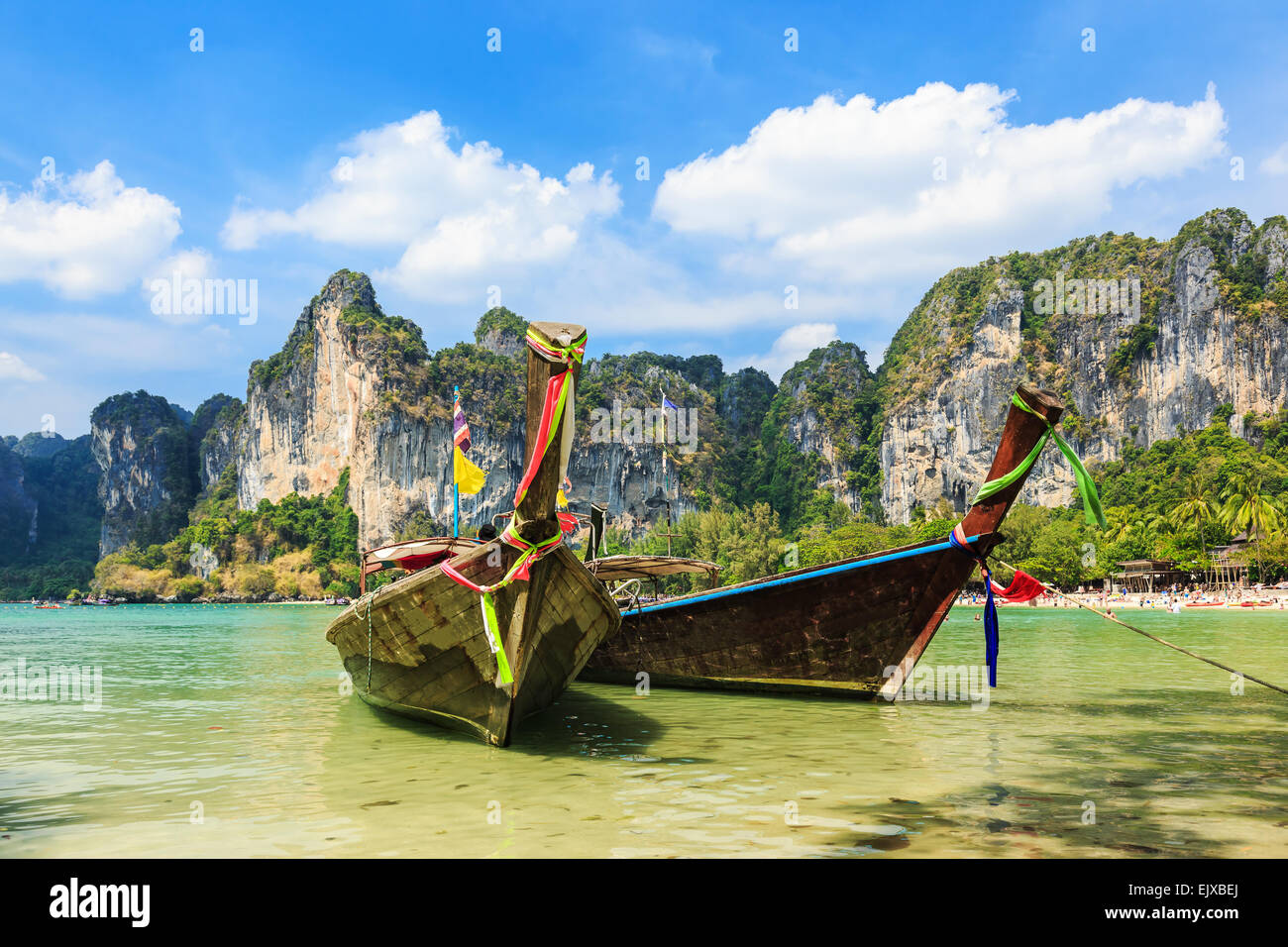 Long Tail boats at the Railay West Beach, Thailand. - Stock Image