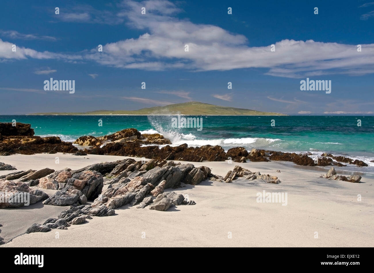 view to pabbay from berneray with rock and surf - Stock Image