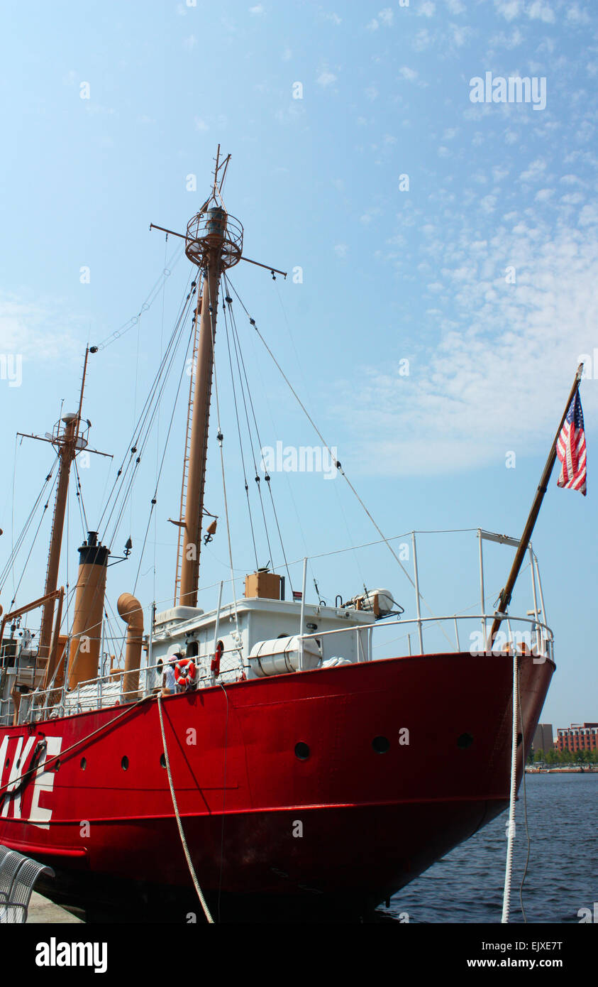 Red ship outside national aquarium in Baltimore, Maryland, USA Stock Photo