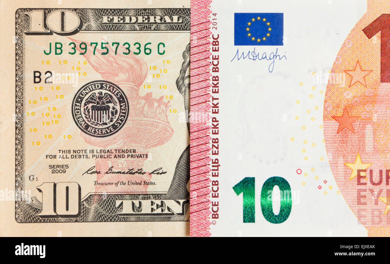 Parity of US dollar and Euro exchange rate symbolized by half bills - Stock Image
