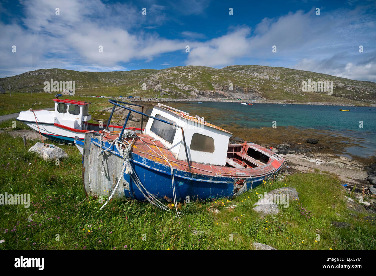 beached boats on vatersay in summer colours - Stock Image