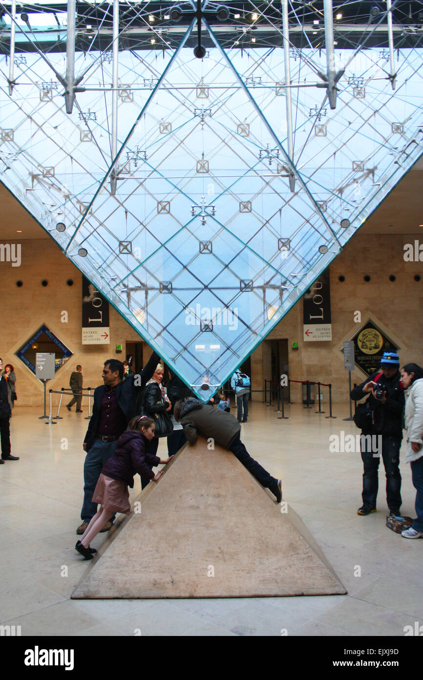 Inverted glass prims in Louvre Museum in Paris, France - Stock Image