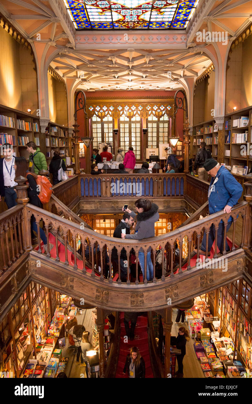 Tourists inside the lello library,Along with Bertrand in Lisbon, it is one of the oldest bookstores in Portugal. - Stock Image
