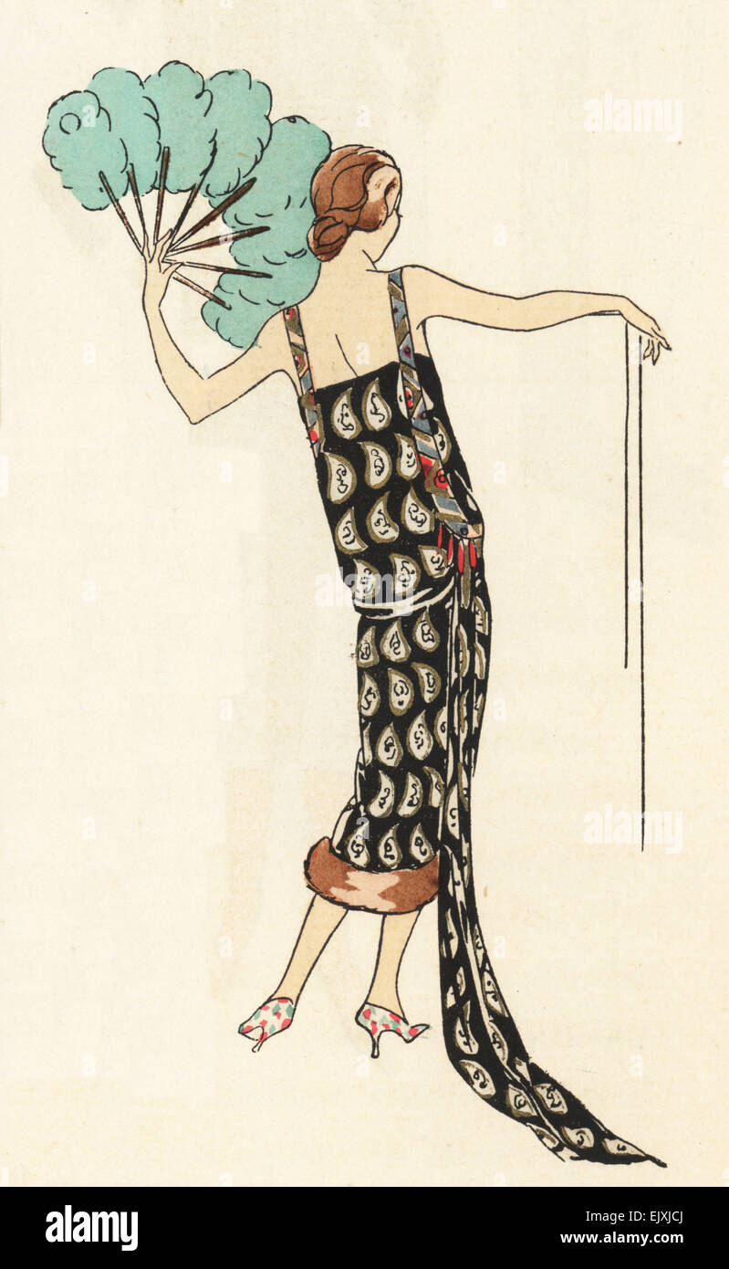 Evening dress in silver and gold lame on black trimmed with coral beads, 1925. - Stock Image