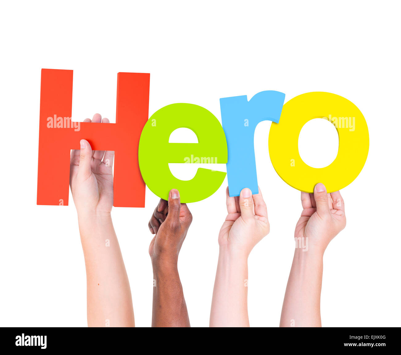 Multi-Ethnic Group Of People's Arms Raised Holding Letters That Form Hero - Stock Image