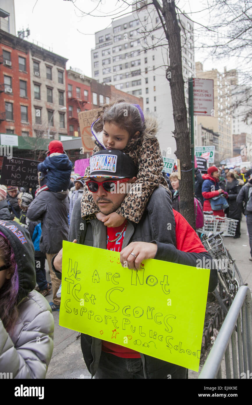 Large demonstration  at New York Governor's  office in NYC telling him to fund public education and support - Stock Image