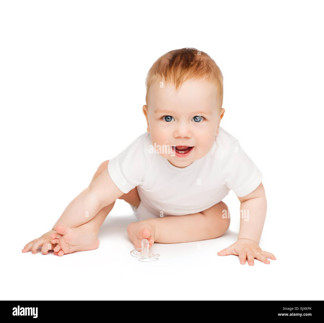 smiling baby sitting on the floor - Stock Image