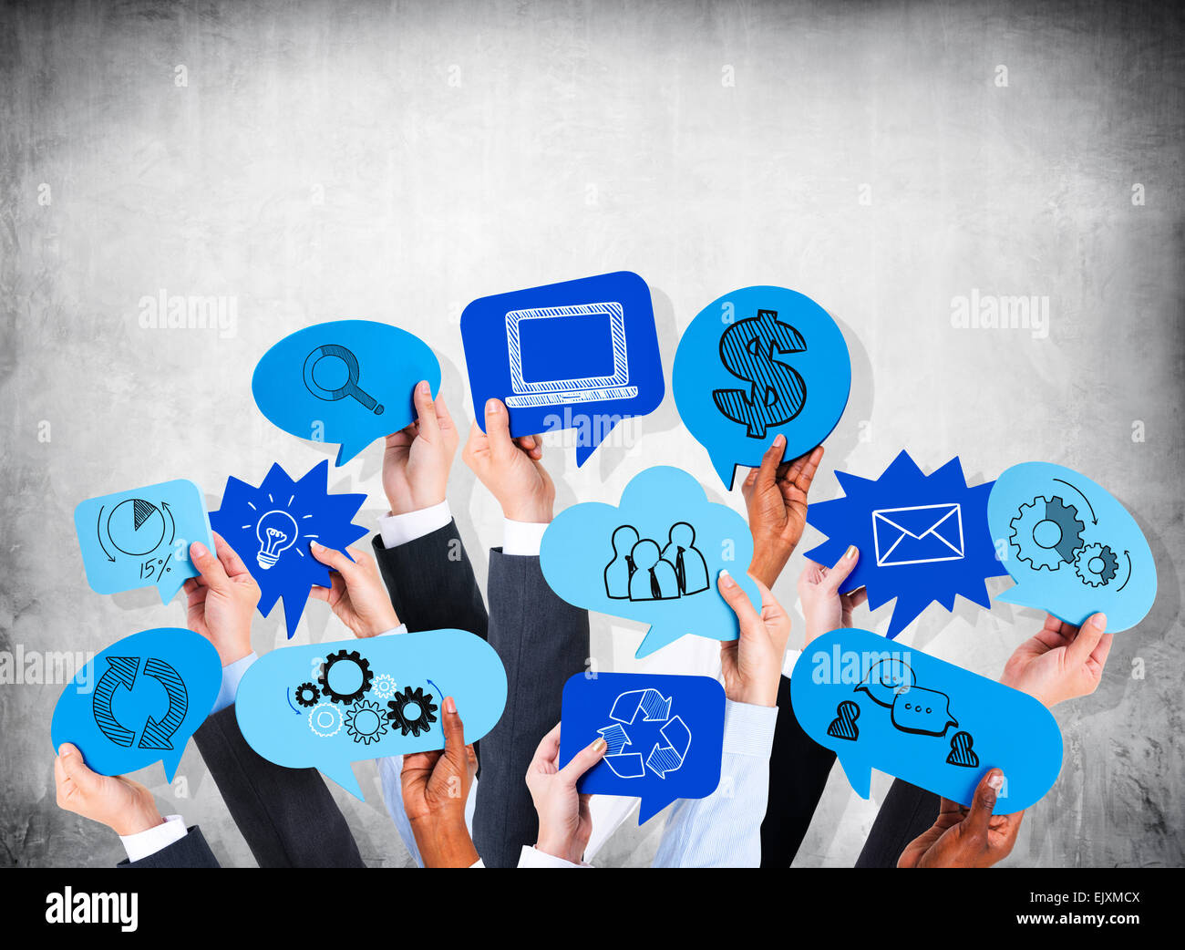 Business people's hands holding the speech bubble with business theme. - Stock Image