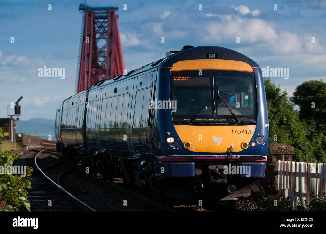 A Scotrail passenger train crosses the Forth Rail Bridge on the way from Edinburgh to Fife.  picture by Alex Hewitt - Stock Image
