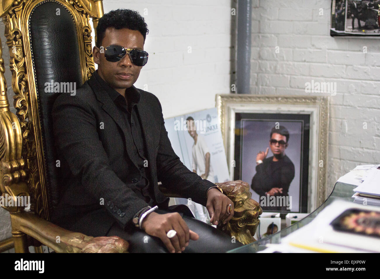 South African Fashion Designer David Tlale Poses In His Office In Stock Photo Alamy