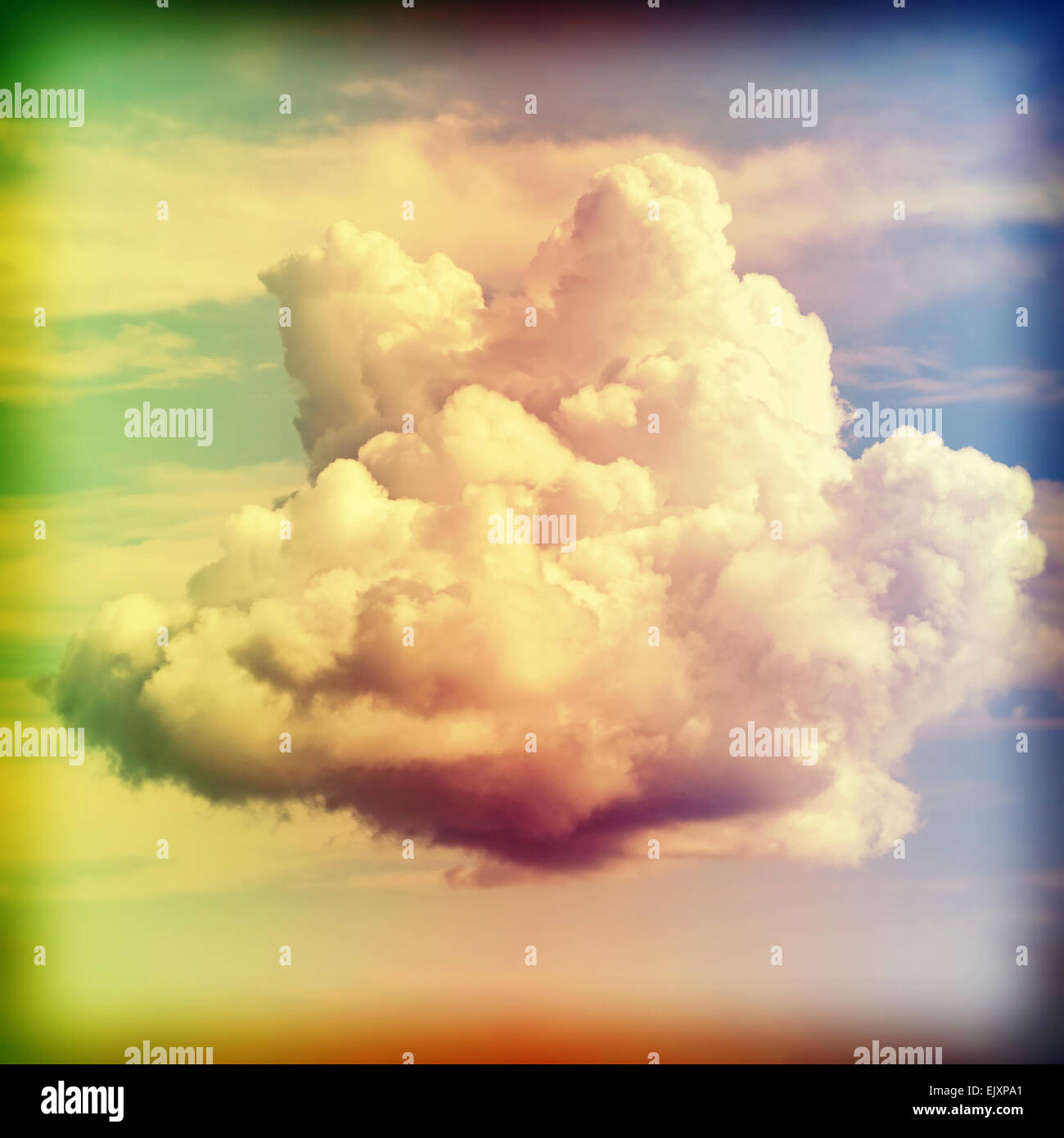 Cross processed old film style picture of a cloud. - Stock Image