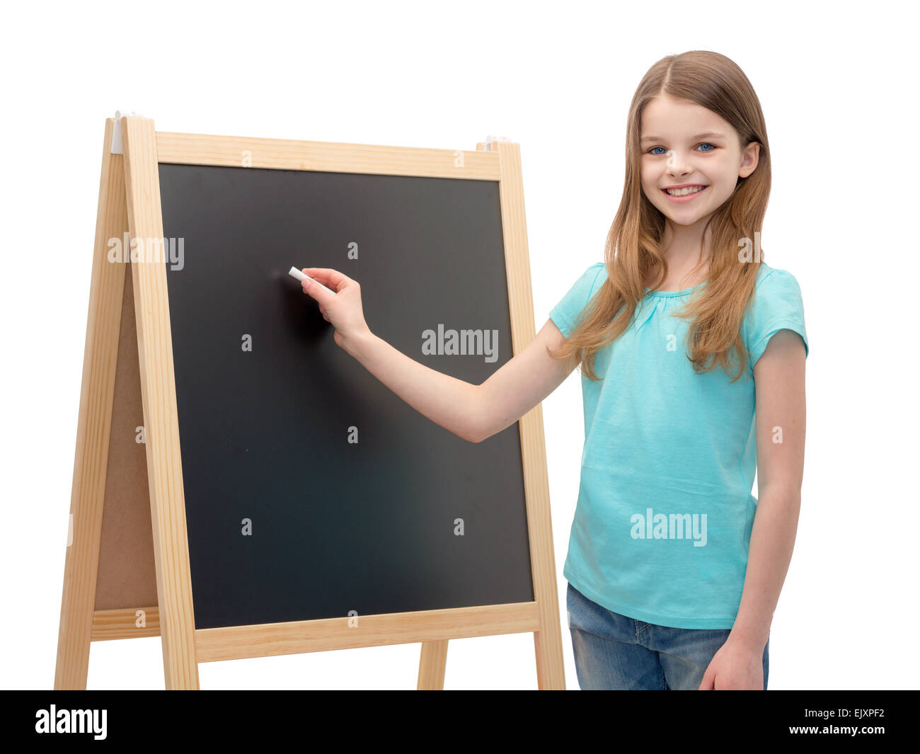happy little girl with blackboard and chalk - Stock Image