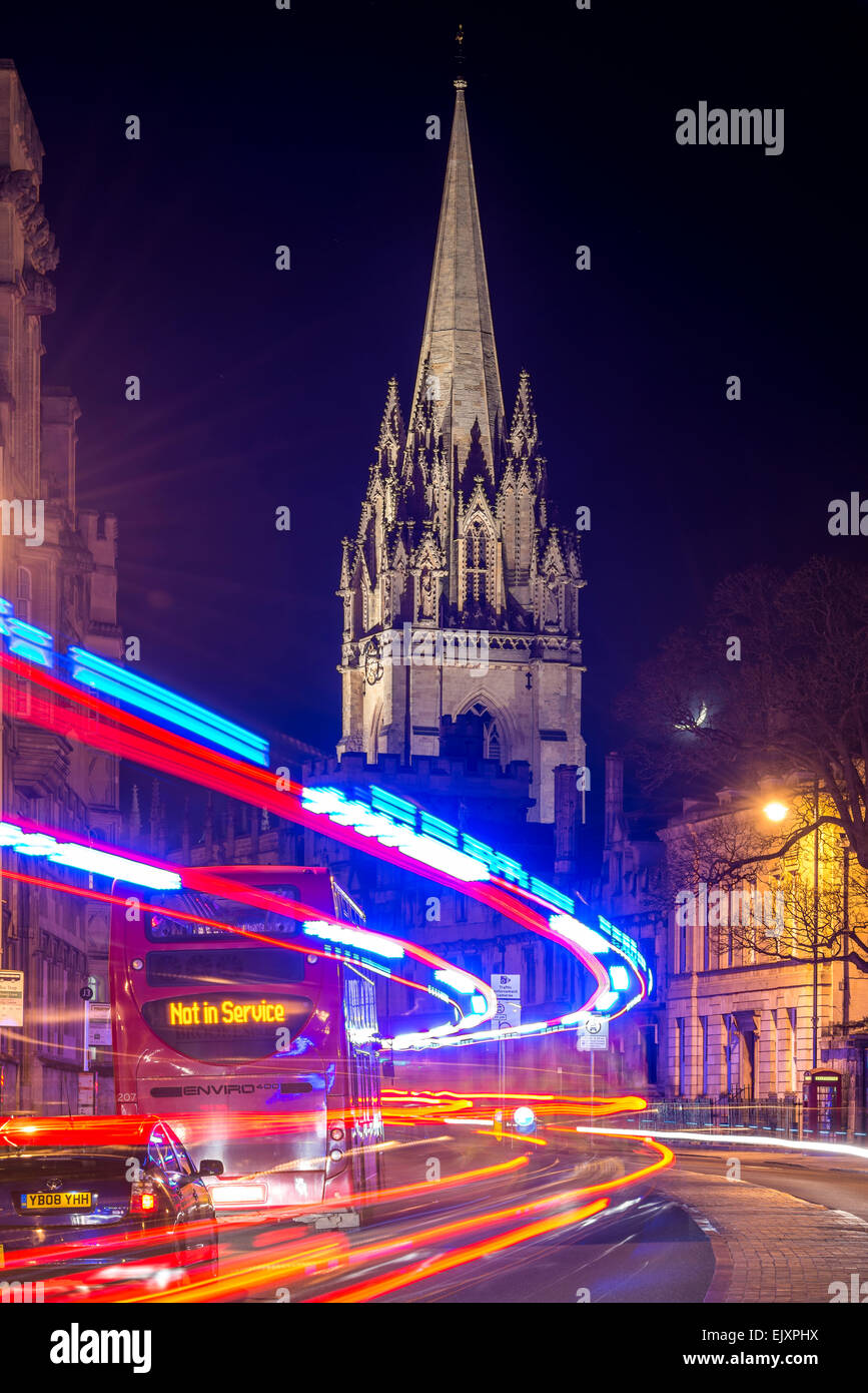 The University Church of St Mary from the High Street, Oxford as traffic passes by a bus that is Not in Service - Stock Image