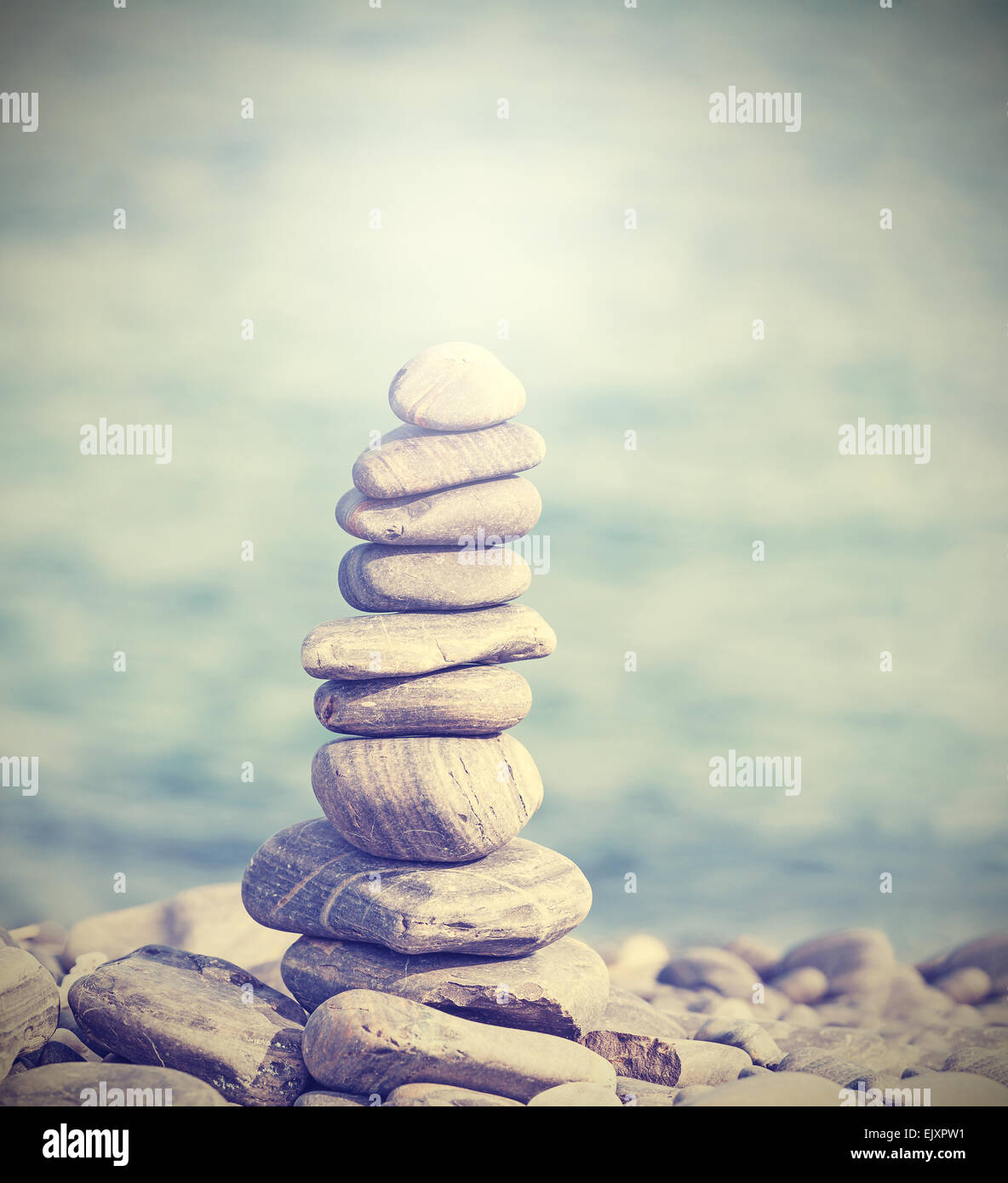 Retro filtered heap of stones, Zen spa concept background. - Stock Image