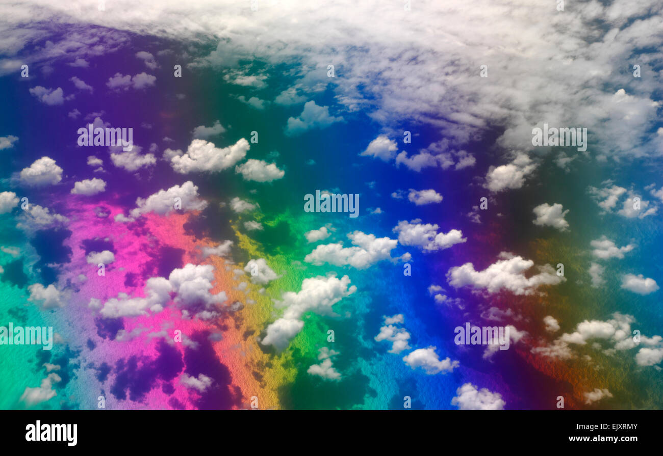 Spectrum colors over the ocean surface with clouds above - Stock Image