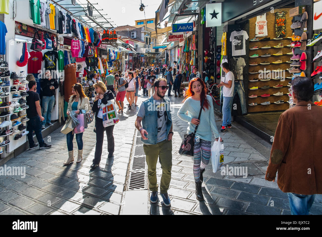 casual people casually walking strolling browsing shopping street market souk athens greece - Stock Image