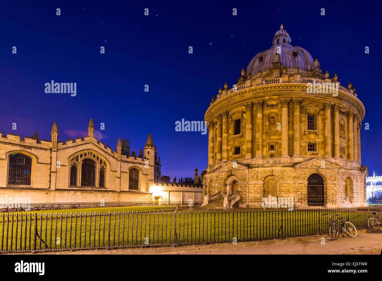 The Radcliffe Camera is a reading room of the Bodleian Library, Oxford University. Seen here at night with All Souls - Stock Image