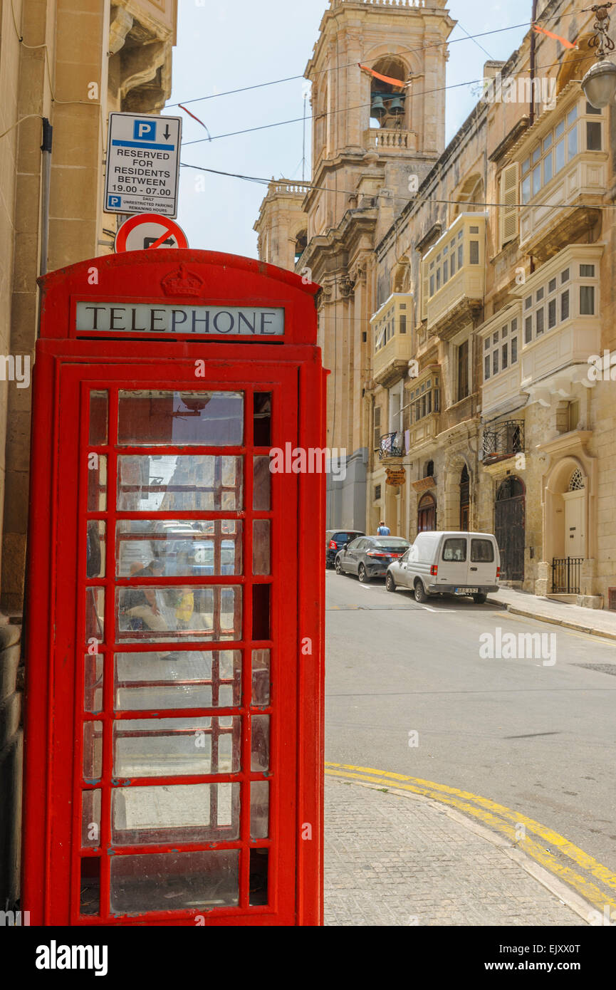 An old UK telephone kiosk in Valletta, Malta. - Stock Image