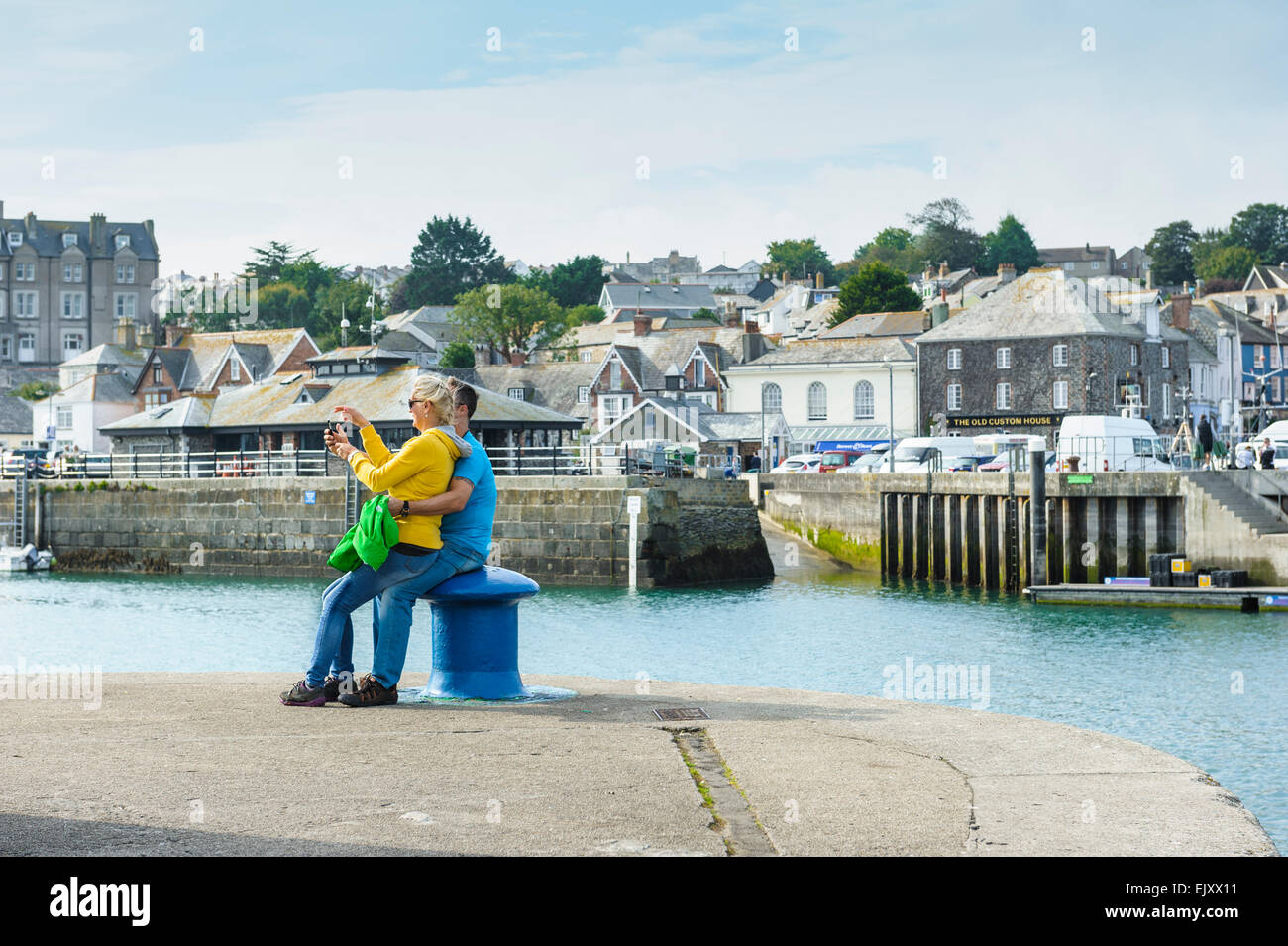 A couple in their thirties taking a selfie at Padstow, Cornwall. Stock Photo