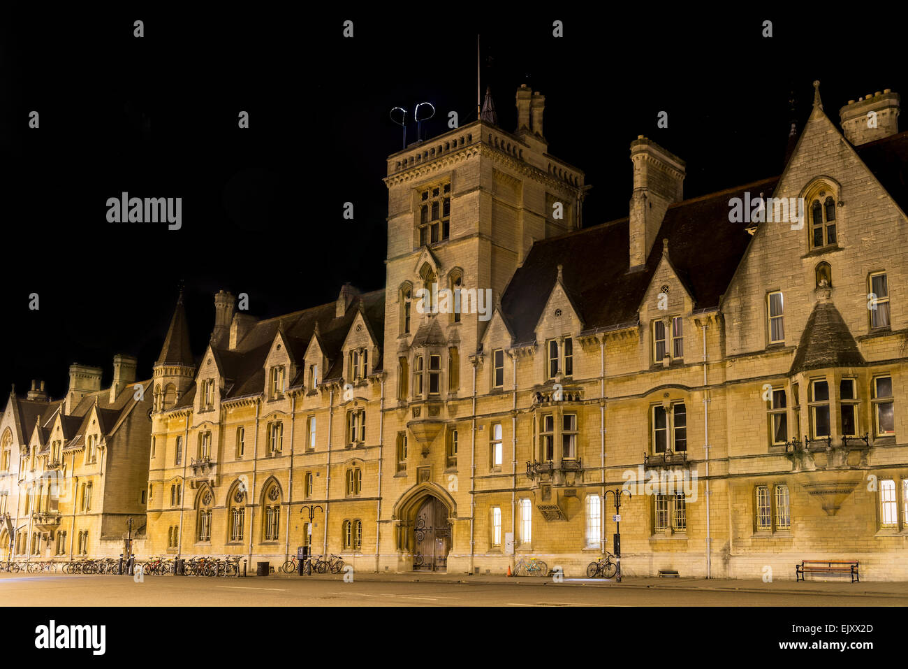 Balliol College, seen here lit up at night is an undergraduate college and part of Oxford University, Oxford, UK - Stock Image