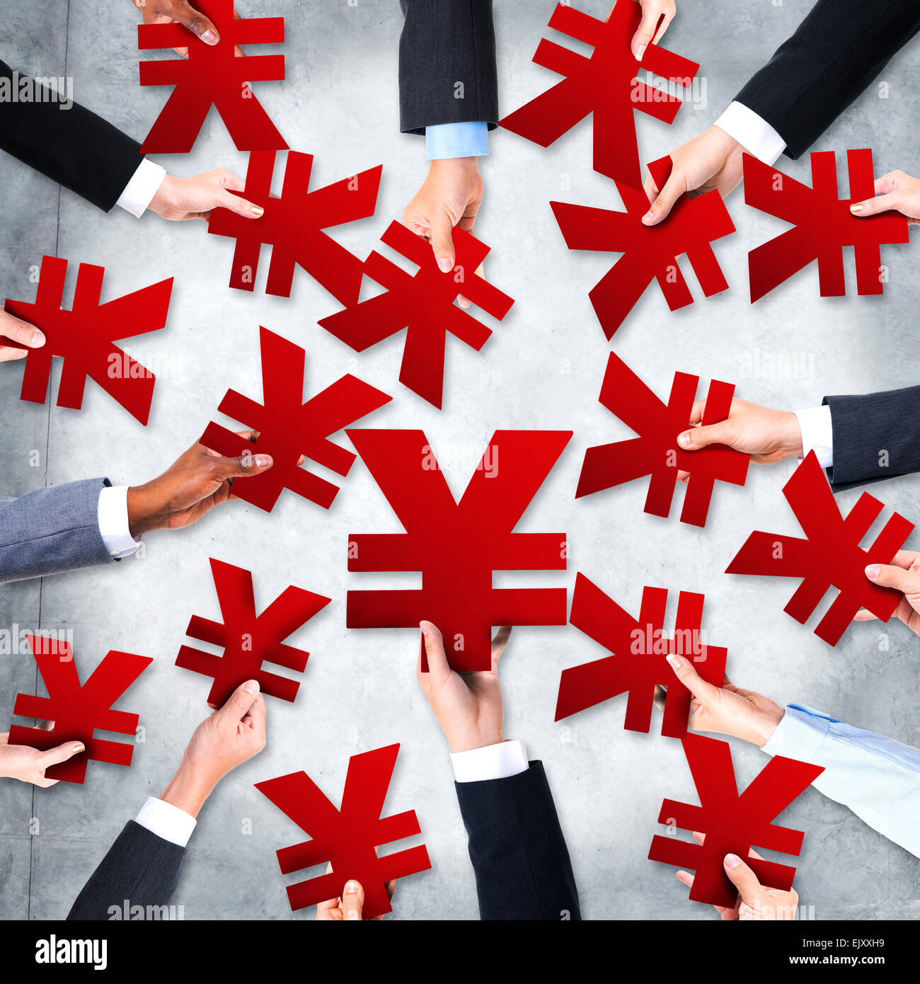 Group of Business People's Hands Holding Yen Symbols - Stock Image