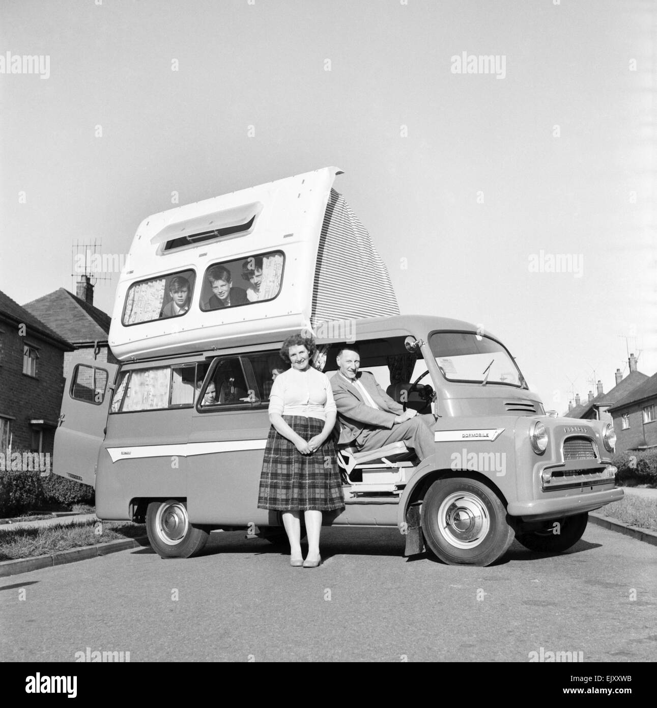 Holidays: Camping. The Astley family seen here getting to grips with their new Dormobile camper van. 1960. - Stock Image