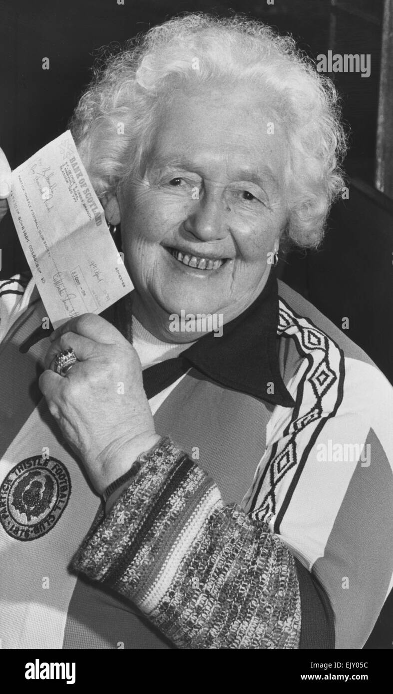 Margaret Cameron, 85, holds up her cheque for !000 after winning the first draw in the new Partick Thistle lottery. - Stock Image