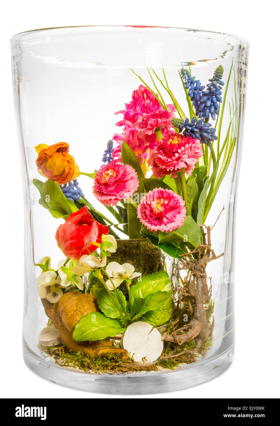 Bouquet Of Artificial Flowers Made Of Plastic In A Big Glass Vase Stock Photo Alamy