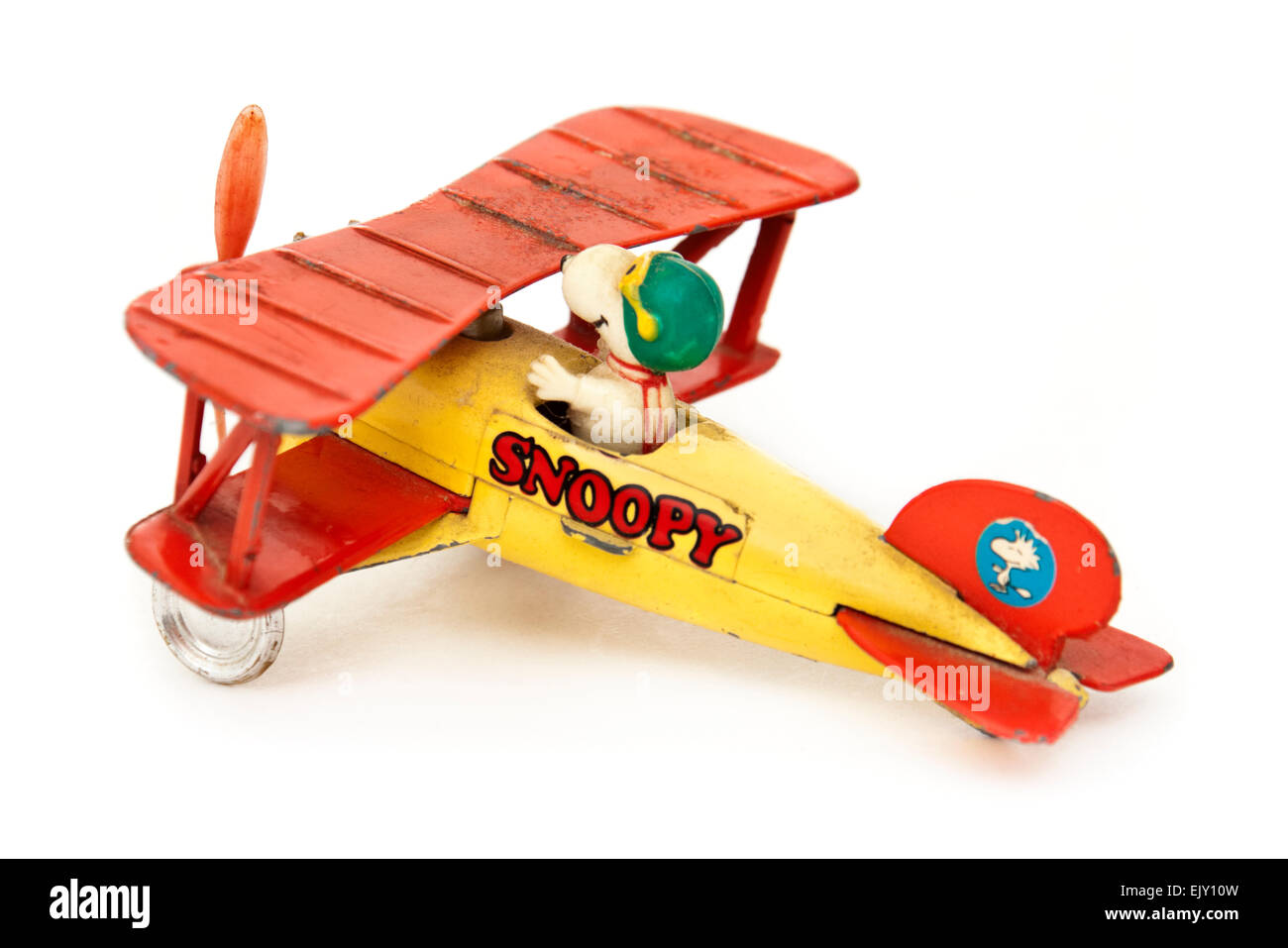 Snoopy (Charlie Brown's dog in Peanuts comic strip) vintage diecast toy airplane by Aviva Toy Co. from 1965 - Stock Image