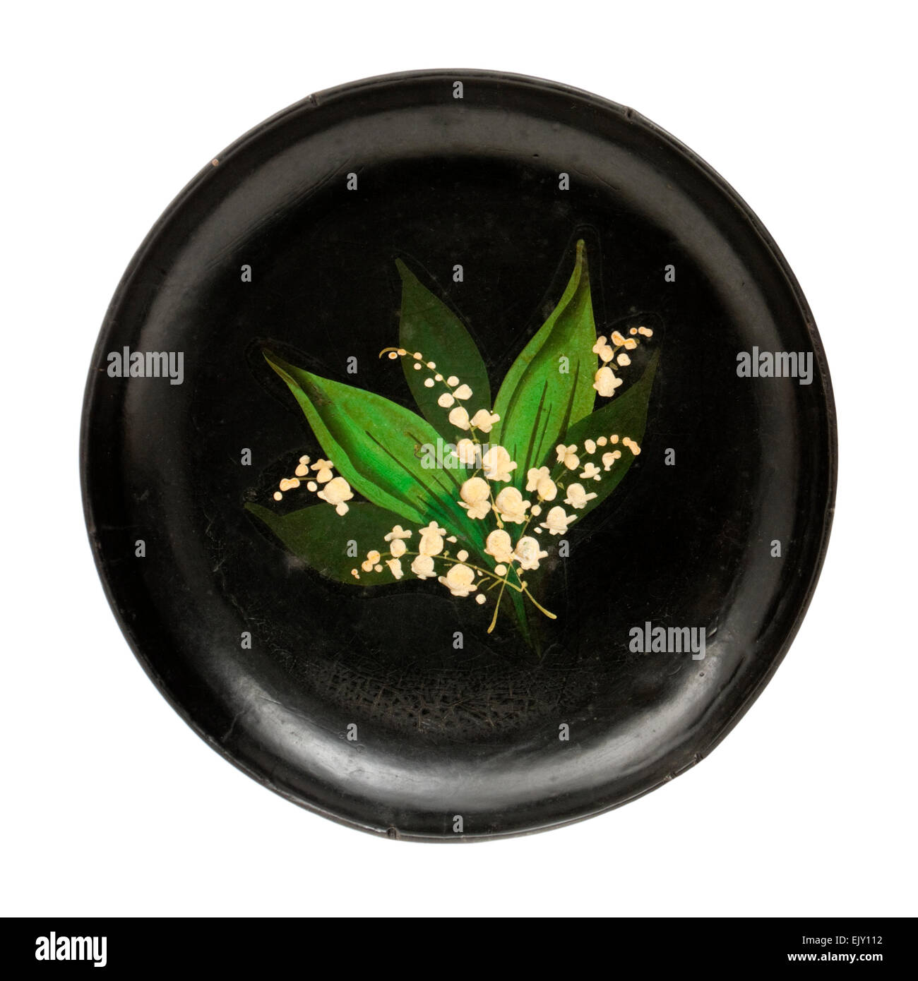 Antique Papier-mâché plate with Lily-of-the-Valley floral decoration - Stock Image