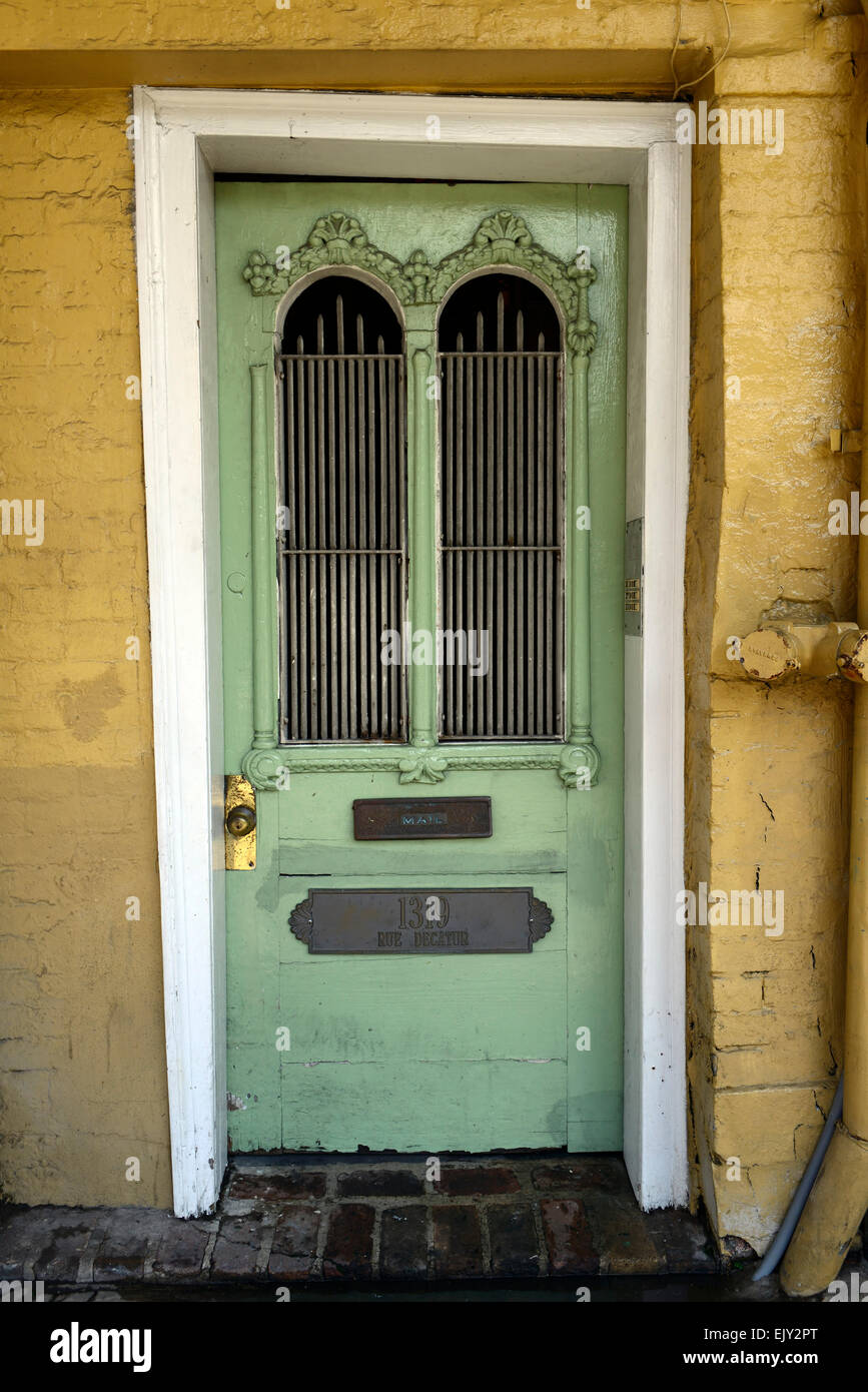 green door yellow bricks 1319 rue decatur ornate old door entrance french quarter new orleans RM USA - Stock Image