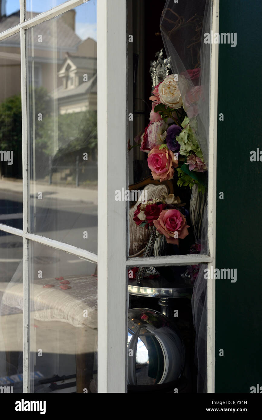 fake plastic flowers flower bouquet roses carnations window display shop shopping RM USA - Stock Image