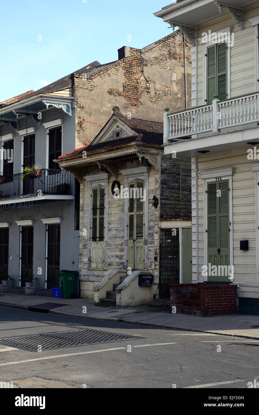 old historic building sandwiched between newer homes houses smaller french quarter new orleans louisiana RM USA Stock Photo