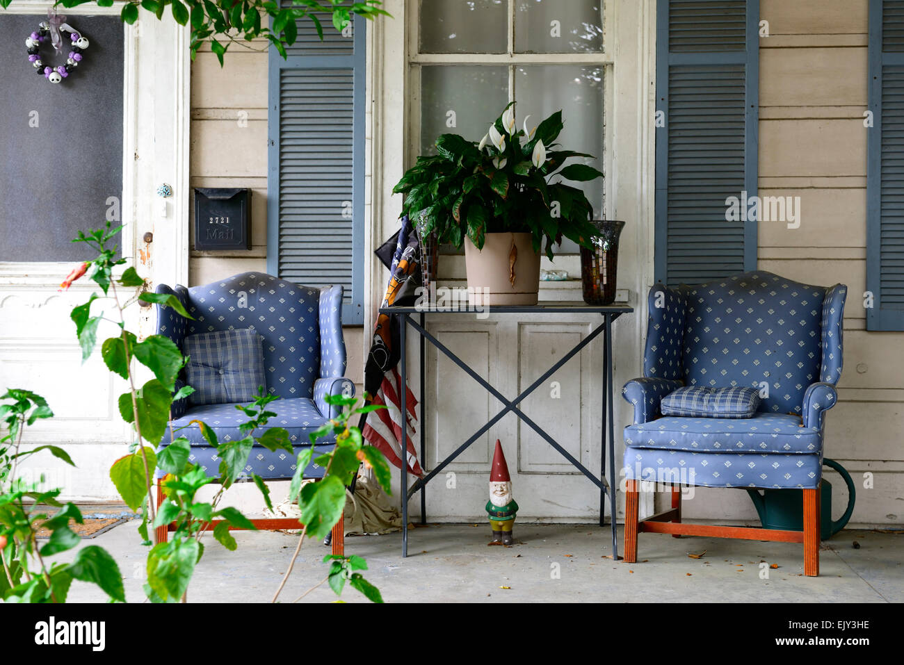 patio porch gnome comfy seats seating french quarter new orleans louisiana RM USA Stock Photo